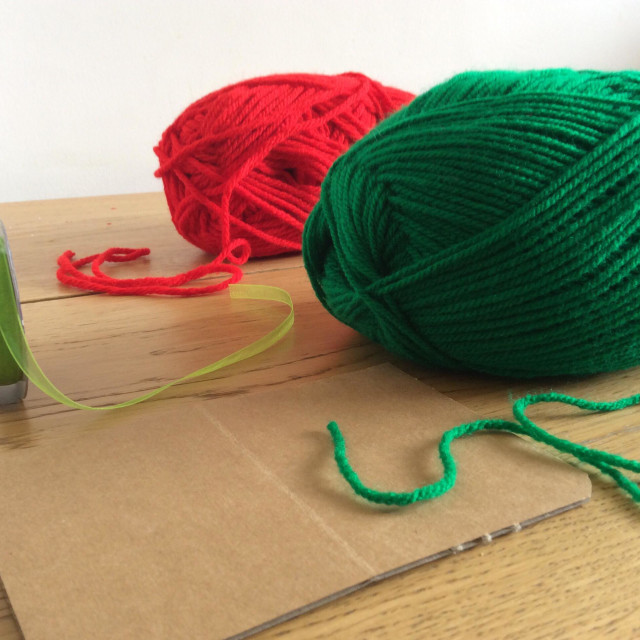 """""""Materials to make a homemade toy. Balls of wool, cardboard and ribbon"""" stock image"""