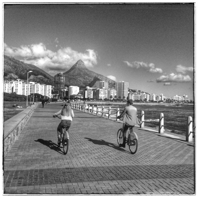 """Couple cycling along Seapoint promenade."" stock image"