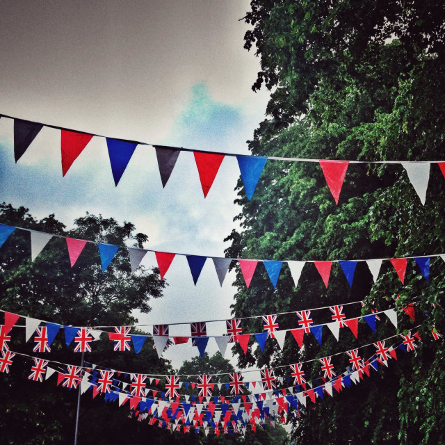 """""""Bunting under a cloudy sky with aged grainy effect."""" stock image"""