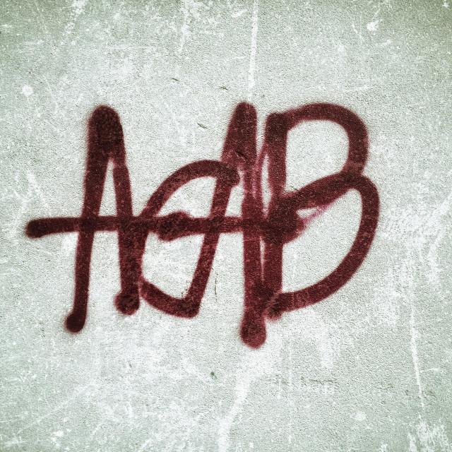 """Graffiti in abandoned warehouse"" stock image"