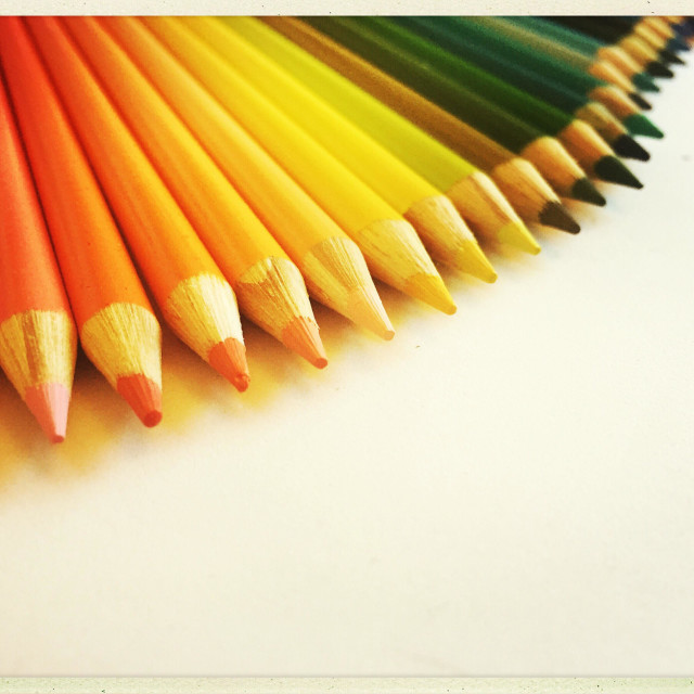 """""""Brightly coloured sharp pencils displayed in a fan pattern on a white background"""" stock image"""