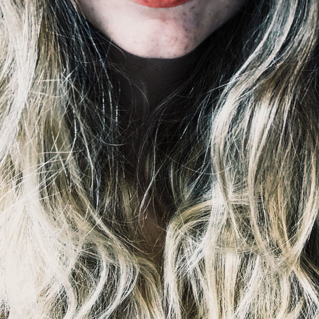 """""""Girl with red lips, freckles and blond wavy hair"""" stock image"""