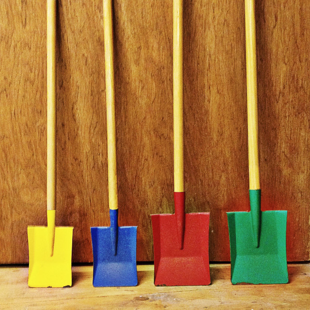 """Coloured spades leaning against garden shed"" stock image"