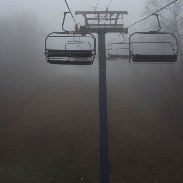 """Fog on a ski lift"" stock image"