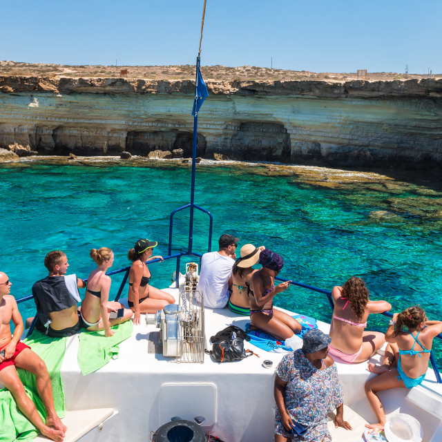"""AGIA NAPA, CYPRUS: tourists observing sea caves from a cruise boat."" stock image"