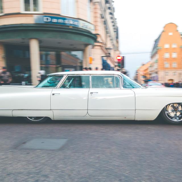 """American classic car cruising down the main street"" stock image"