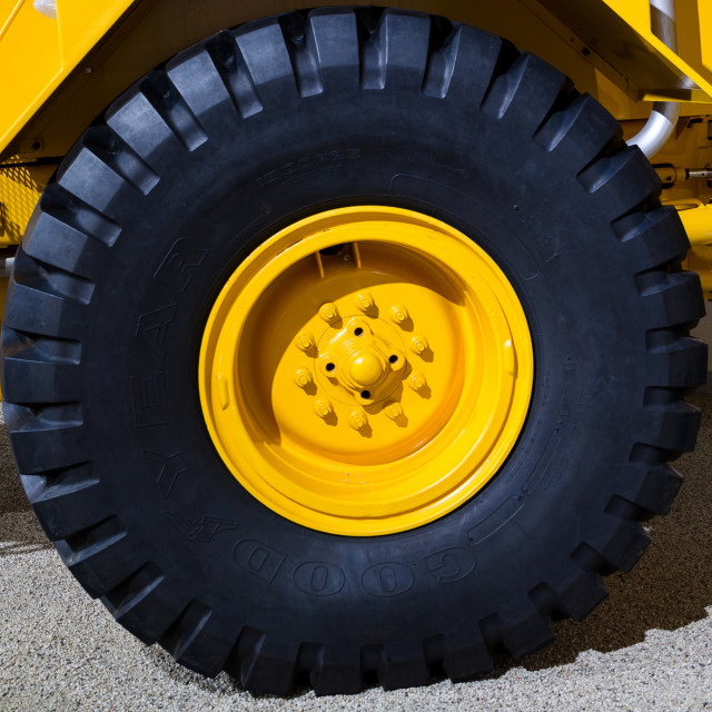 """""""one big wheel to a dumper"""" stock image"""