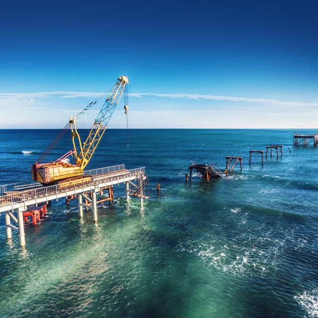 """Aerial view of work crane on the broken bridge"" stock image"