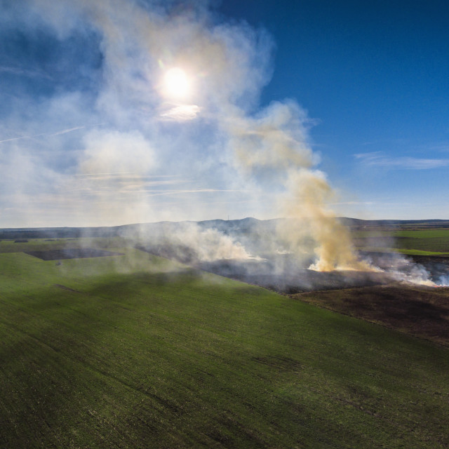 """""""Aerial view of fire on autumn field"""" stock image"""