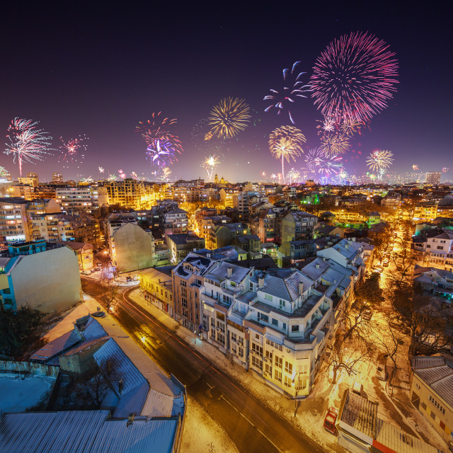 """Downtown Varna cityscape with many flashing fireworks celebratin"" stock image"