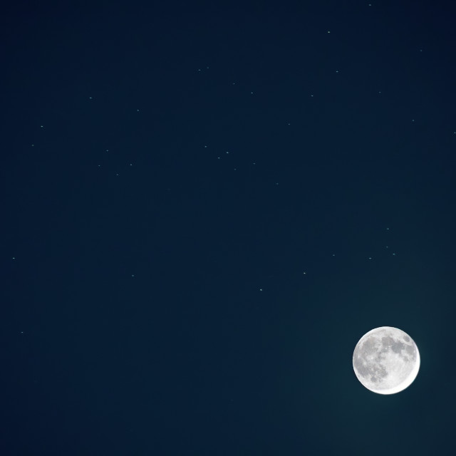 """Full blue moon with star at dark night sky background"" stock image"