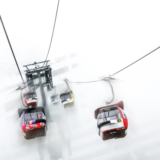 """Cable cars in the mist"" stock image"