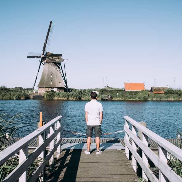 """Man looking at the windmill"" stock image"