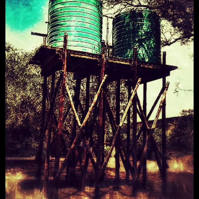 """Water barrels at hide, Hluhluwe-iMfolozi Park, KwaZulu Natal, South Africa"" stock image"