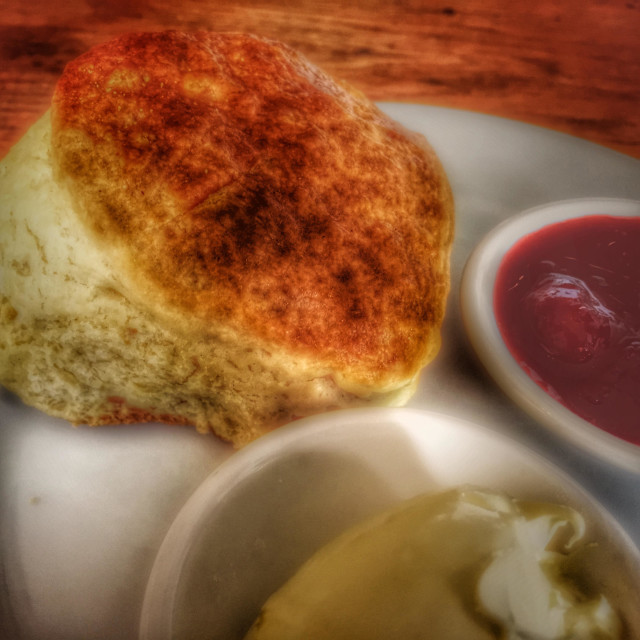"""English cream tea. Scone with jam and fresh cream."" stock image"