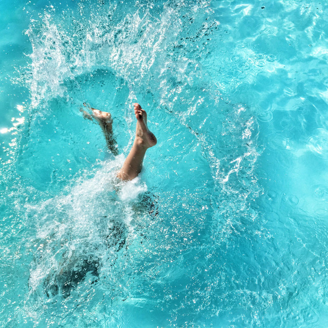 """""""Child diving in a swimming pool."""" stock image"""