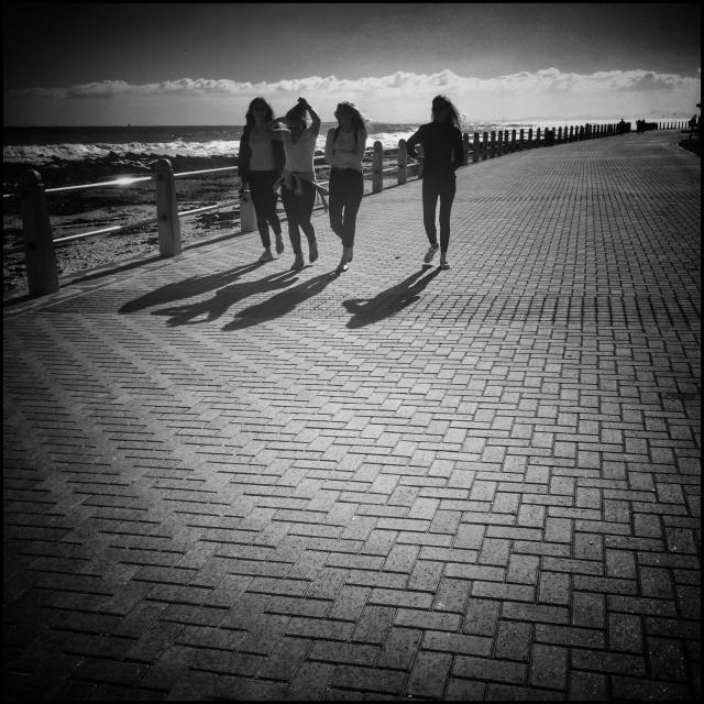 """""""Group of young women walking along the Seapoint promenade in Cape Town."""" stock image"""