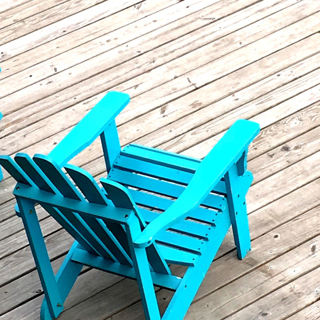"""""""Blue Adirondack chair on a dock"""" stock image"""