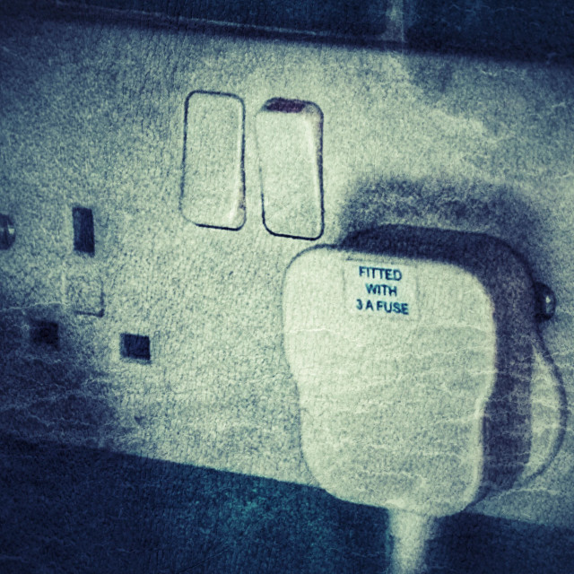 """""""Plug in a double socket, switch on."""" stock image"""