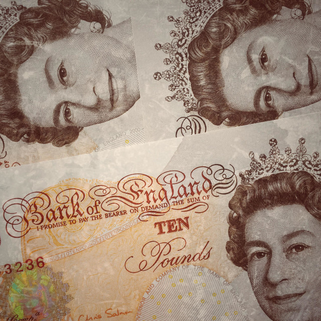 """Three Bank of England Ten Pound Notes arranged in a way so that Queen Elizabeth II's portrait is clearly visible. Photograph © COLIN HOSKINS."" stock image"