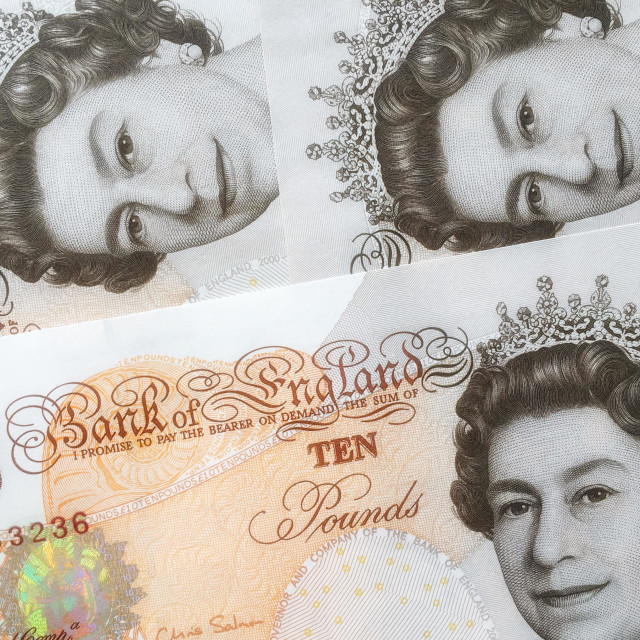"""Three duplicate portrait pictures of Queen Elizabeth II ad depicted on the Bank of England's Ten Pound Sterling Note (Bank Bill). An image to illustrate money, economy, inflation or deflation."" stock image"