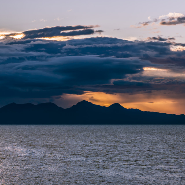 """Sunset storm over the Isle of Rum"" stock image"