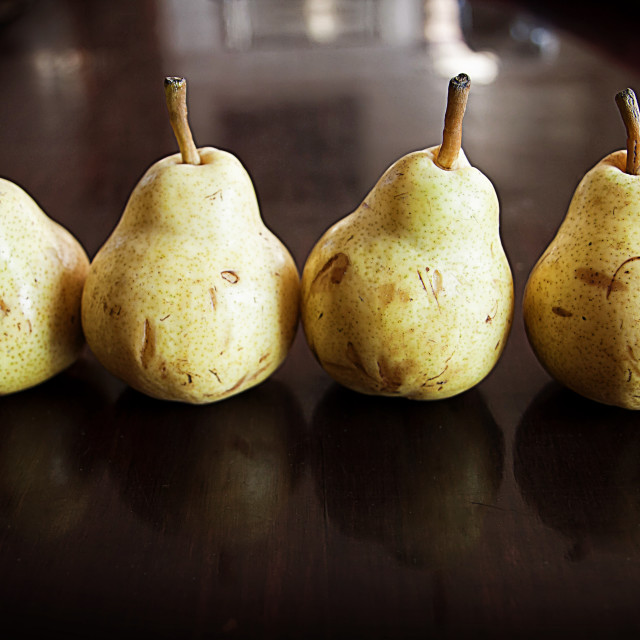 """Four ripe pears in a row"" stock image"