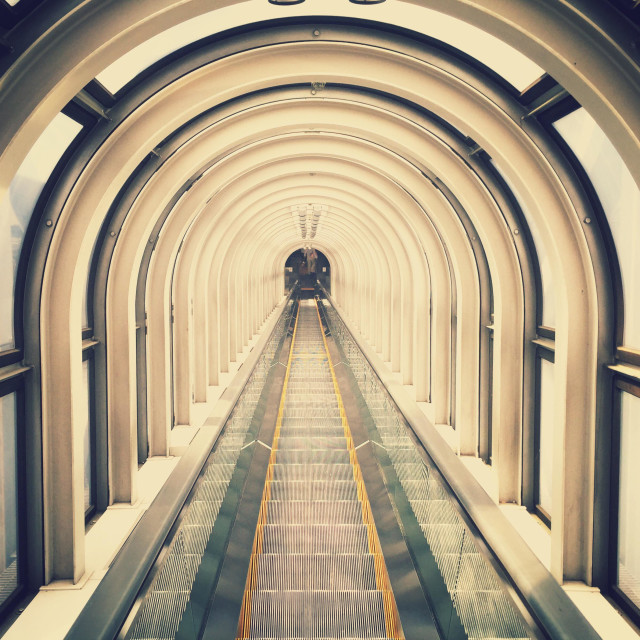 """Long escalator up a building in Japan"" stock image"