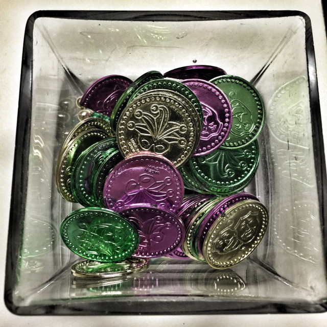 """Mardi Gras coins in a jar"" stock image"
