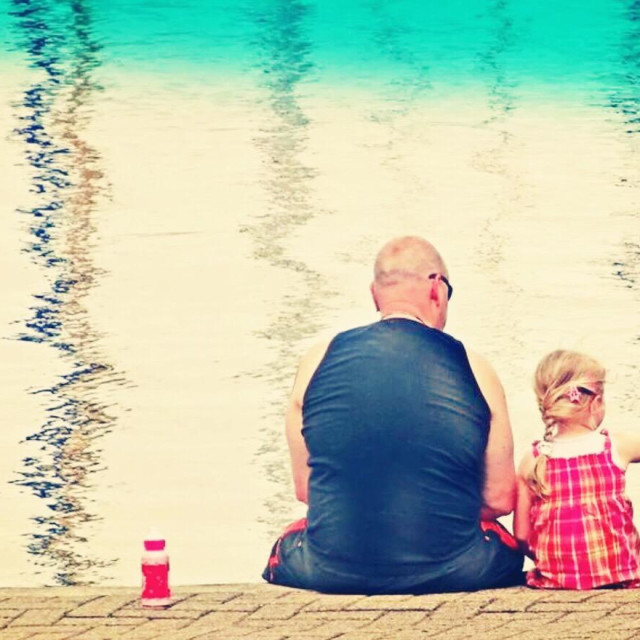 """""""Father and daughter at the sea."""" stock image"""