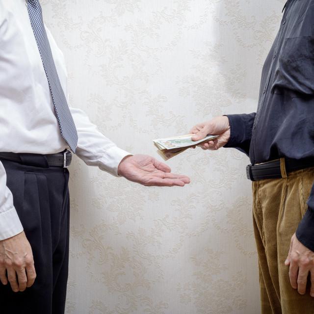 """Man Paying a Dollars Bribe to a Corupted Nan Accepting It"" stock image"
