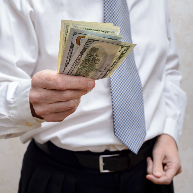 """Businessman, or politician, offering a Dollar banknotes bribe fo"" stock image"
