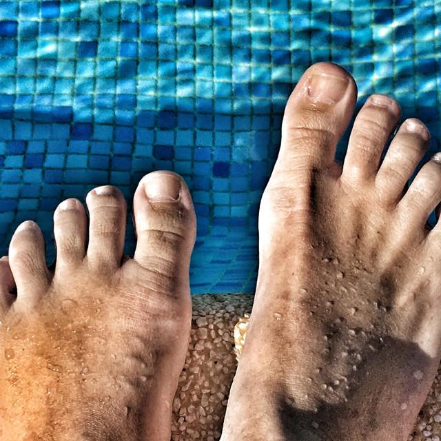 """Summer fun. Feet by swimming pool."" stock image"