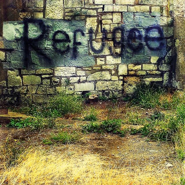 """Refugee graffiti on wall"" stock image"