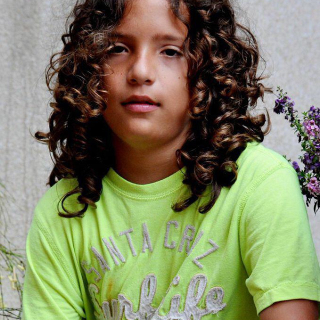 """Boy with Long and curly hair"" stock image"