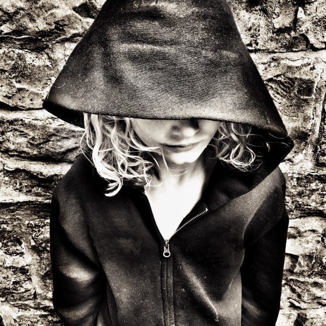 """""""Young girl with face covered by hoody"""" stock image"""