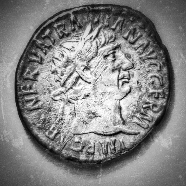 """Roman silver denarius. Trajan. 98-117 CE. Obverse. Laureate bust, looking right. Inscription: IMP CAES NERVA TRAIAN AVG GERM"" stock image"