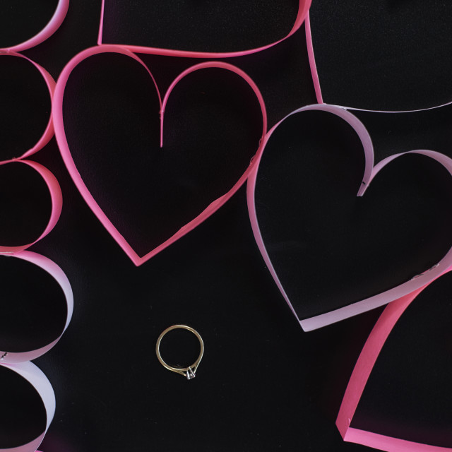 """Gold ring among pink hearts"" stock image"