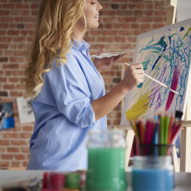 """""""Passionate woman while painting image"""" stock image"""