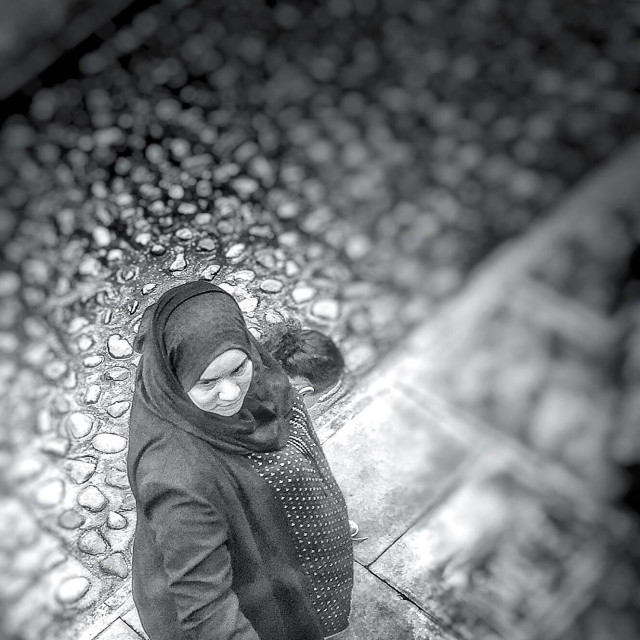 """Woman in a hijab, seen and photographed candidly from a high angle. London, U.K."" stock image"