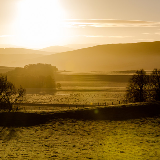 """Scotland highlands at cold winter clear sunrise air sky"" stock image"