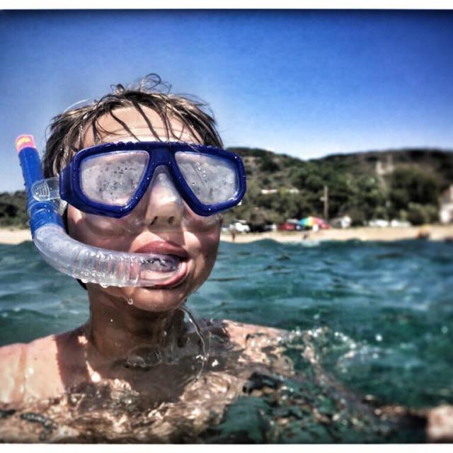 """Boy snorkelling"" stock image"