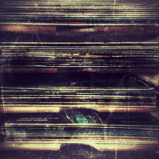 """""""Stacks of old vinyl records on shelves in an old record cabinet."""" stock image"""