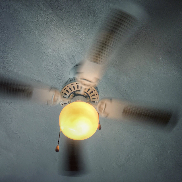 """""""Ceiling fan and light, in use"""" stock image"""