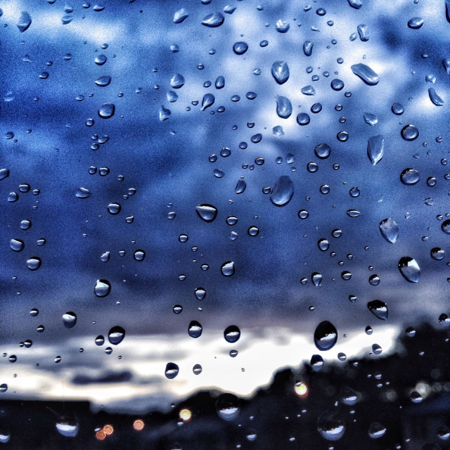 """""""Raindrops on window with cloudy sunset"""" stock image"""