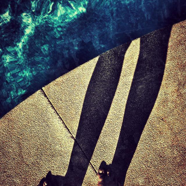 """POV. Feet, shadow and swimming pool."" stock image"