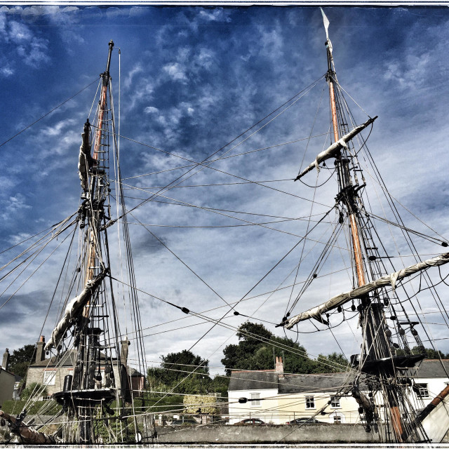"""""""Masts and rigging of old wooden sailing boat in harbour at Charlestown Cornwall"""" stock image"""