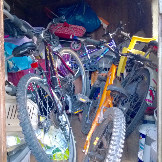 """""""Untidy cluttered shed full of stuff."""" stock image"""