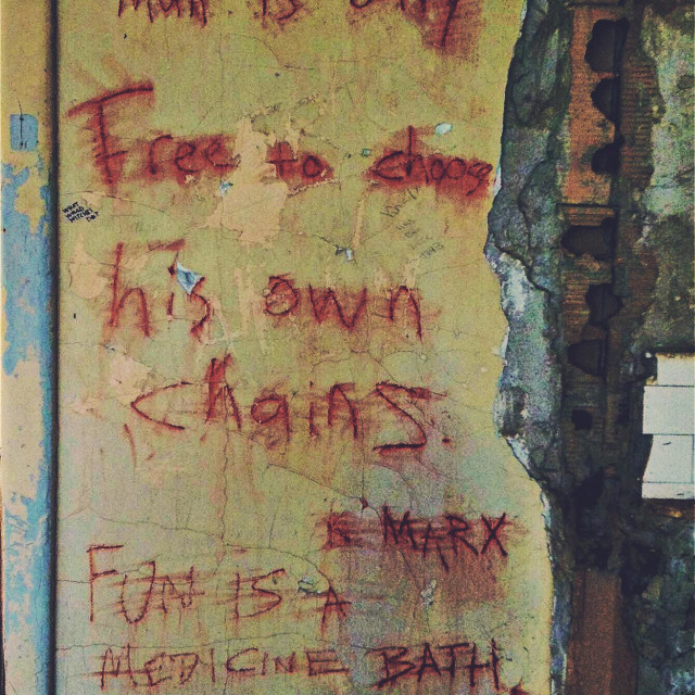 """""""Graffitied quotes on a wall of an abandoned building. Angel Island, California."""" stock image"""