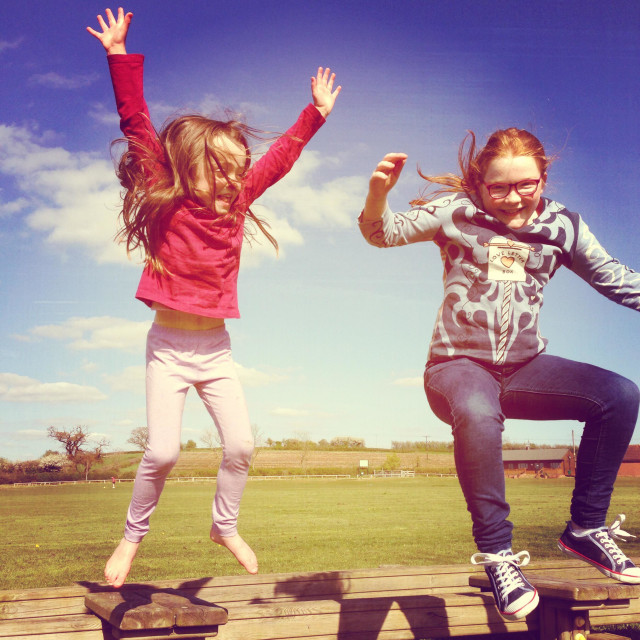 """""""Girls jumping on the Trim Trail"""" stock image"""